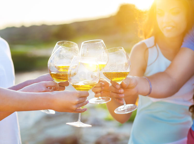 people-holding-glasses-white-wine